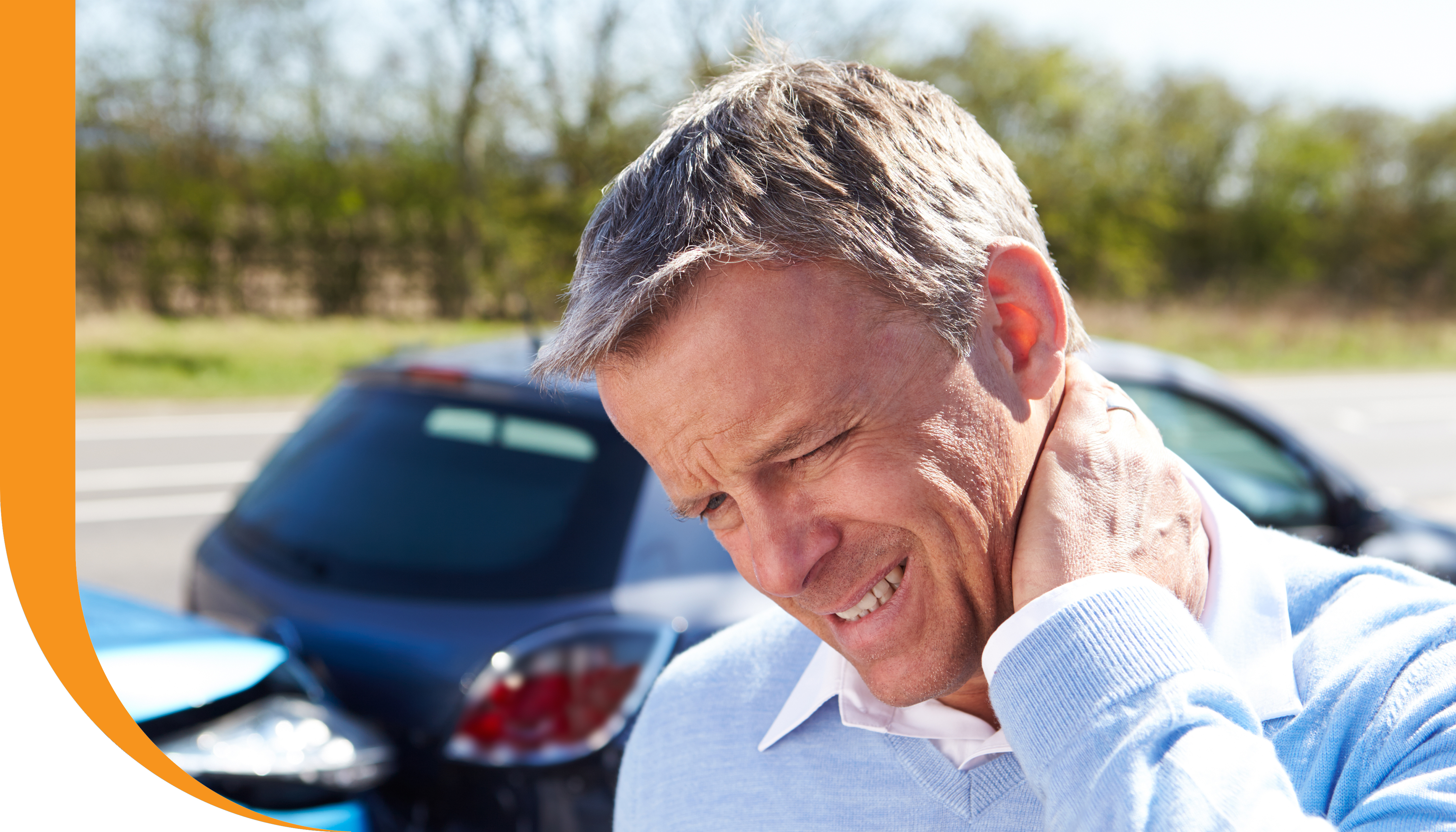A man feeling neck pain after a car accident.