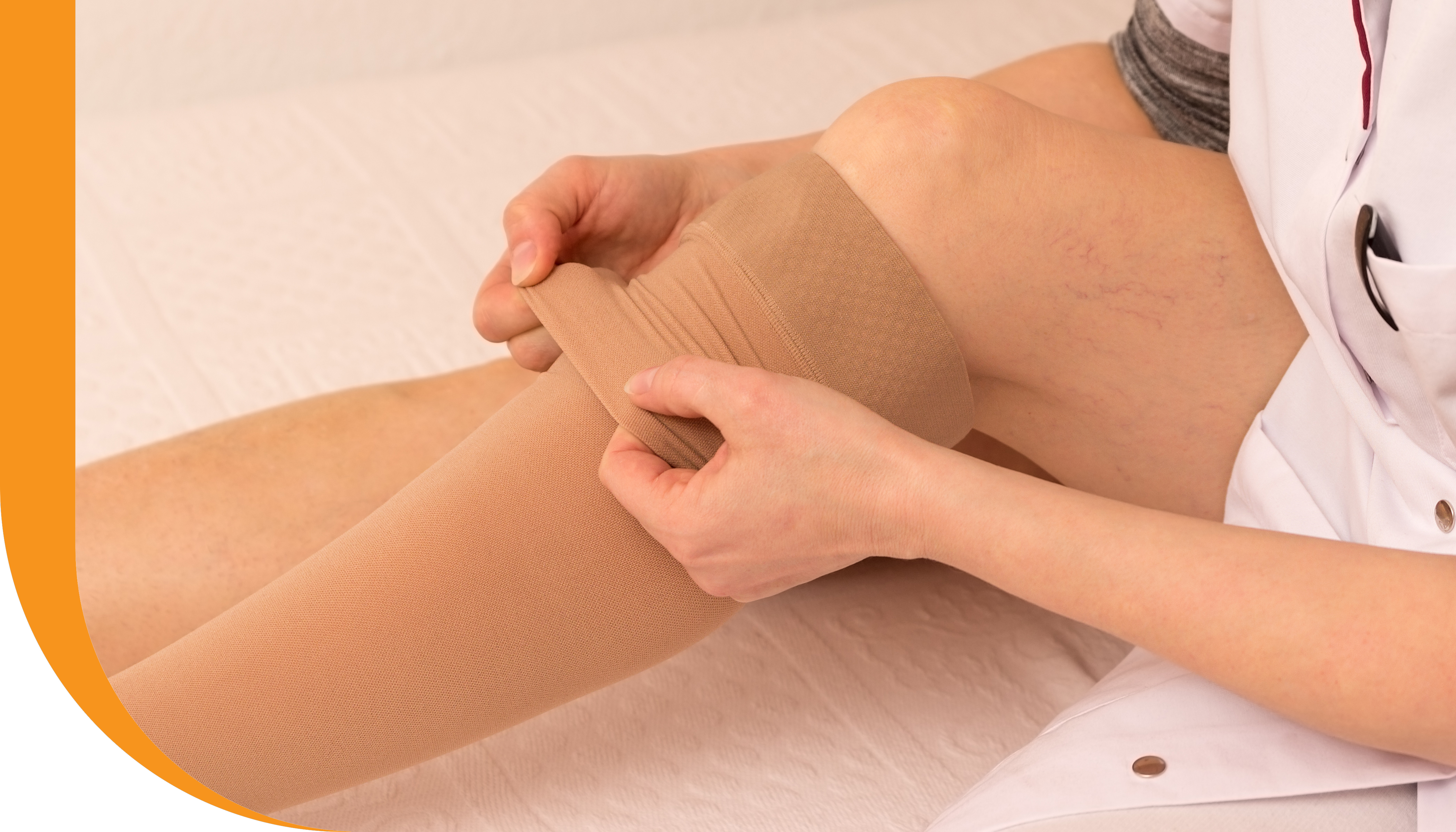 A woman putting on compression stockings.