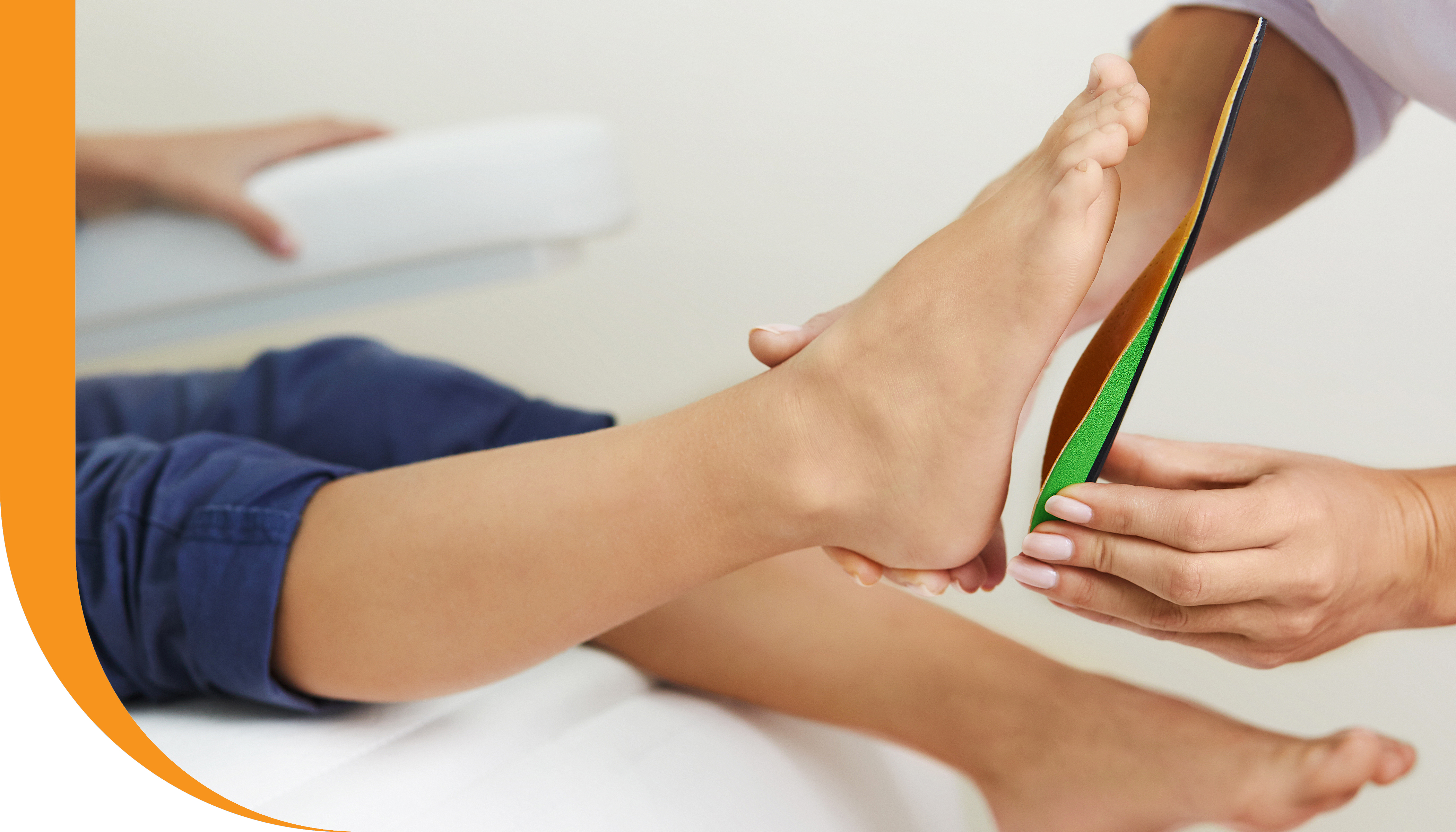 A patient being fitted for custom orthotics.