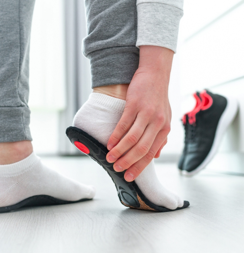 A patient trying out their custom orthotic inserts.
