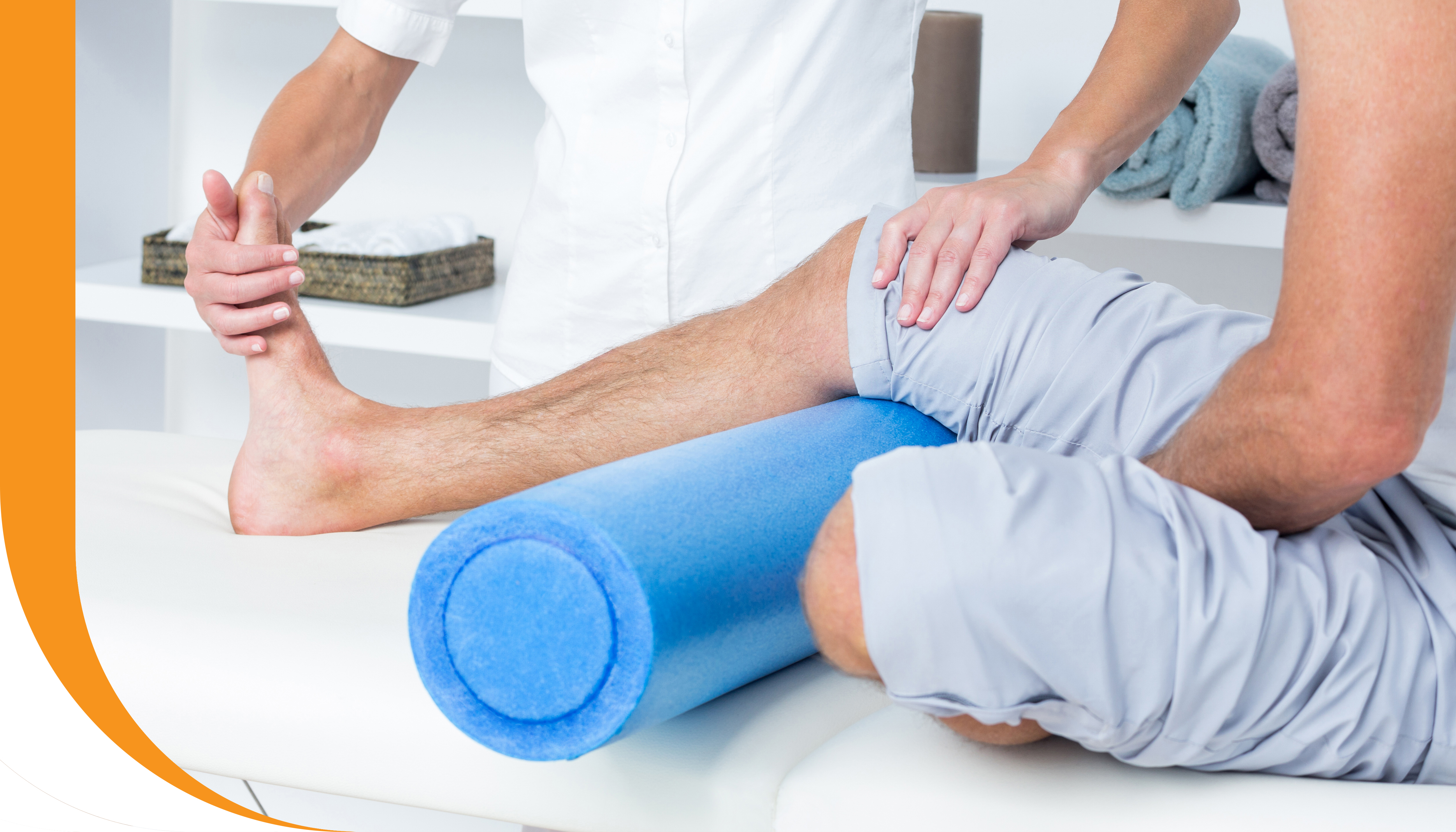 A physiotherapist performing a stretch on a patient's leg and foot.