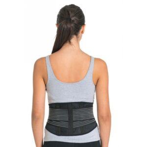 A patient wearing a lower back brace.