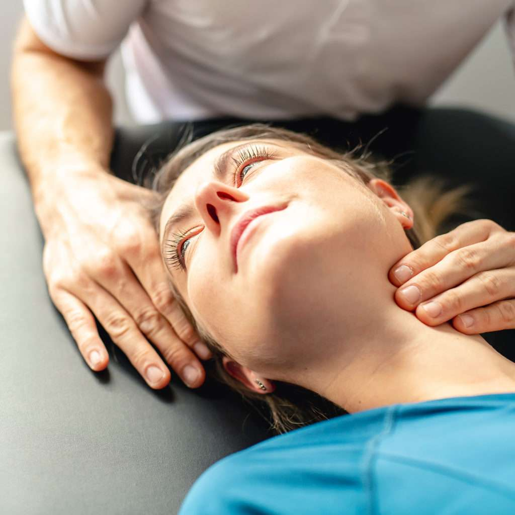 Woman Seeing a Neck Pain Specialist