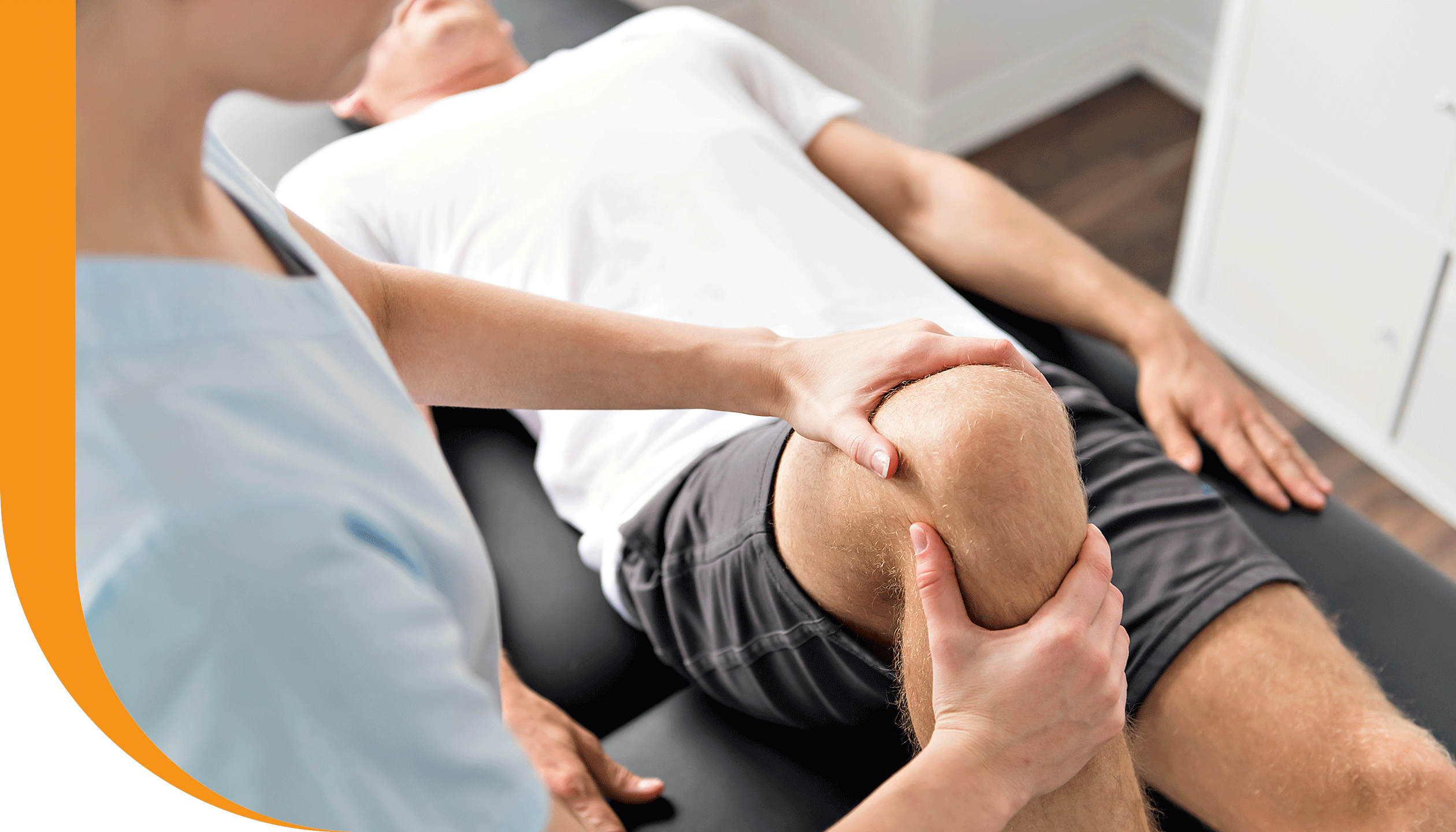 A patient with a sports injury receives knee physiotherapy.