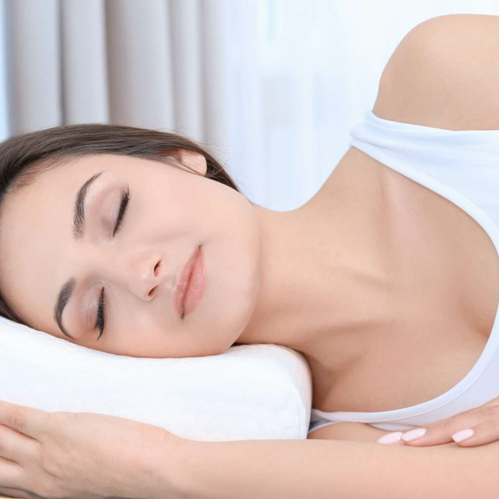 Woman Sleeping With A Support Pillow